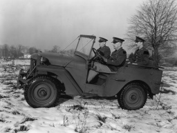 U.S. Army personnel driver a Willys-built army Jeep. Dec. 7, 1940 Blade Photo